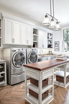 Farmhouse Laundry room. Farmhouse Laundry room. Farmhouse Laundry room. Folding table is a custom piece. Lighting is Feiss, Hobson Collection #FarmhouseLaundryroom Forte Building Group LLC