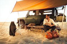 This is actually from a bag manufacturer but I love the whole Land Rover with sun shade in the desert thing.