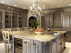 Don't care for the light color but the concept of the big kitchen island with seating is nice!