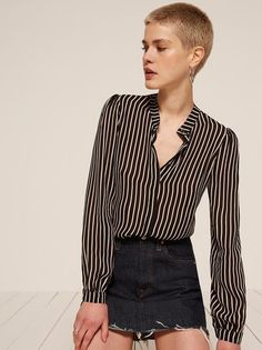 Don't get too attached - limited edition prints. This is a long sleeve, button front top with a mandarin collar.