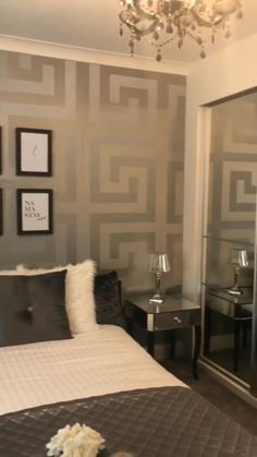 The Versace Large Greek Key Wallpaper in Silver. A Grand Statement wall that enhances ultimate deluxe luxury throughout any room. For more colourways and similar designs visit ilovewallpaper.co.uk #ilovewallpaper #roomdecor #homeaccessorises #wall #homeaccents #wallpaper