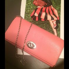 EPOC Coach Combo CrossBody/ Wallet Chain Strap Lovely, versatile Authentic Coach cantelope shade of light melon/coral wallet that doubles as a wonderful CrossBody clutch! Silver tone bead ball shoulder strap glass up even the most basic outfit. Large enough to fit phone, $, a few cosmetics & cards. Looks great layered with the pewter CrossBody phone bag or any other petit accessory bag. A nice pop of color for spring / summer 2016 price firm, but bundled, you can get more goodies for an even…