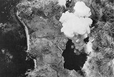 Bombs dropped from a U.S. bomber detonate on Japanese-occupied Kiska Island, Alaska, on August 10, 1943.