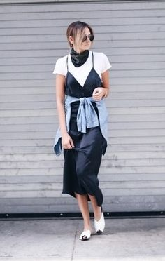 Exactly how to wear a slip dress this summer: layer a t-shirt under it. Make it cool like We Wore What by wrapping a denim shirt around your waist.