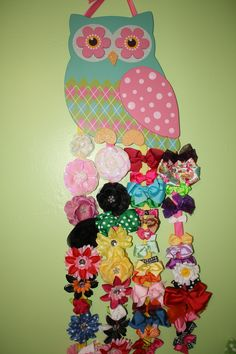 The girls second hair bow holder. I made it using ribbon and owl wall decor (only $9) from Hobby Lobby.