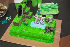 Simple Minecraft Cake with Minecraft figures added.