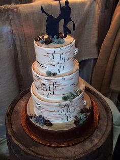 Birch tree look  for a rustic barn wedding . Accented with succulents . The wood base is cake too !