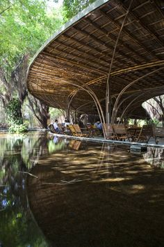 beautiful contemporized indigenous structure at wNw Cafe / Vo Trong Nghia Vietnam
