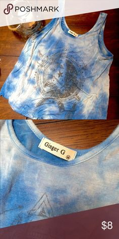 Blue tie dye graphic tank top NOT BRANDY! Only worn twice. Baggier flowy tank top. I'm a small and it fit me but is probably best for a medium body, also can fit large. I tied one of the sides into a knot and it fit perfectly Brandy Melville Tops Tank Tops