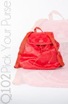 Coach - Getaway Signature Packable Backpack in Red.  Go to wkrq.com to find out how to play Q102's Pick Your Purse!