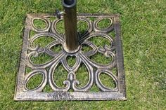 "Cast Iron Square Patio Market Umbrella Base / Stand by Pebble Lane Living. $29.99. Premium Cast Iron Umbrella Base. Upto a 2"" Umbrella Pole. 30lbs. 19"" x 19"" x 15"" H. This Heavy Duty Cast Iron Umbrella Base is Great For Windy Days. Save 70%!"