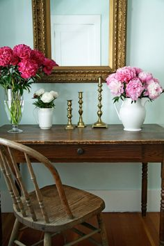 Simple containers, peonies, brass and wood.