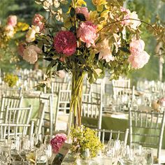 Brides: Dramatic Peony and Orchid Centerpiece. Dramatic centerpieces of peonies and orchids decorated the dinner tables, which were set up on the club%u2019s veranda. All of the floral designs were by David and Denise Clark Floral Art.