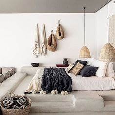 The guest room at @casacookrhodes is looking oh so inviting on this Sunday morning... Smooth concrete floors,beautiful linen covers, fouta towels & rattan pendants... ✨ Image via @casacookrhodes