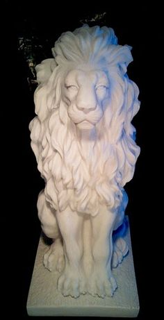 Majestic Marble Lion Statue - Male lion statue seated with beautiful flowing mane. Made from bonded Italian marble and imported from Italy. Beautiful craftsmanship with the highest detail in this piece.