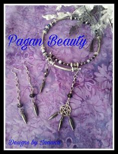 This amazing choker is made with random organization, of blue, purple and all iridescent Swarovski Crystal in 8mm.  Tiny black bicones and silver spacers in discs and tiny silver tone squares separate the grouping. Along with 4 stainless steel tube beads.  A Tibetan Silver Pentacle with gunmetal style spike, dangle on one end. And a pale purple Swarovski Crystal with a spike, dangle on the other. All on memory wire.  This is a choker. And the pic shows how it will set if you currently wear…