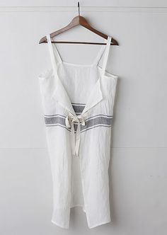 This is an apron but I think it would make a really cute top layered over a  white tank.