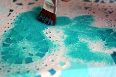 Paper doily as a stencil ~ Mod Podge Rocks!