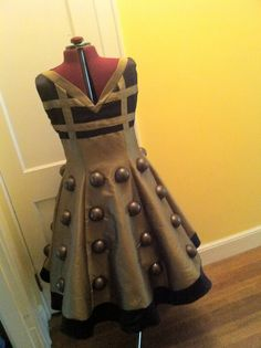 Exterminate! Dalek Dress. Complete with Dalek hat, too! I wouldn't wear it because I hate dresses for the most part, but a cool idea anyway. :-)