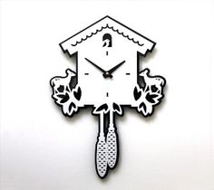 based on the traditional german cuckoo, this modern clock is made of black and white acrylic