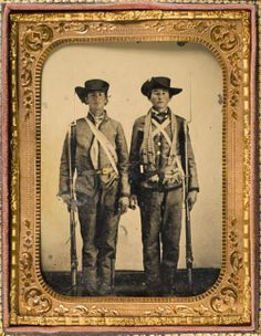 "Brothers, Privates Emzy Taylor (left) and G. M. Taylor, Company E, ""Lone Star Guards"" 4th Texas Infantry Regiment, Hood's Texas Brigade. Emzy  received a discharge for disability for pulmonary disorder on December 4, 1861. He would later raise a company of the 16th Texas Infantry and fought in the Red River Campaign. G. M. Taylor enlisted July 13, 1861 at Waco. He was wounded in the arm at Gaines Mill, June 27, 1862. He surrendered and was paroled at Appomattox in April, 1865."
