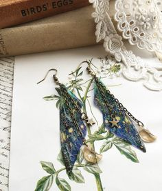 Our NEW SMALL very pretty faerie wings of the nights sky earrings which are just perfect for the more delicate of faerie! We make the wings Funky Jewelry, Ear Jewelry, Cute Jewelry, Jewelery, Jewelry Accessories, Wing Earrings, Unique Earrings, Magical Jewelry, Tiny Prints