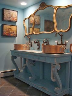 To da loos: His and Her copper stew pot sinks
