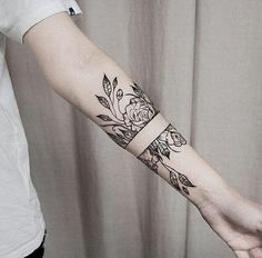 floral geometric tattoo