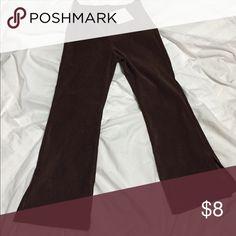 Boutique brand Clique girls brown pants sz 6x NWT Boutique brand girls brown dress pants with flare bottoms with slit on the hem. Brand new with tags. 94% poly and 6% spandex. NWT. Sz 6x clique Bottoms Casual