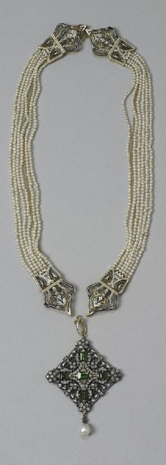 Gold and enamel necklace composed of three components: two sections of six-strands of seed pearls flanking a pendant with five peridots, diamonds, and drop pearl. Pearl And Diamond Necklace, Peridot Necklace, Pearl Jewelry, Antique Jewelry, Gold Jewelry, Jewelery, Vintage Jewelry, Fine Jewelry, Art Nouveau