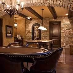 Man cave featuring leather poker table and arched brick ceiling details – Game Room İdeas 2020 Rustic Basement Bar, Man Cave Basement, Basement Doors, Basement Fireplace, Basement Kitchen, Fireplace Design, Ultimate Man Cave, Den Ideas, Man Cave Home Bar