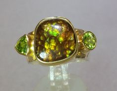 Fire agate ring with peridot by Gemquest on Etsy