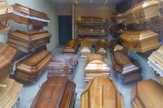 A window display of various wooden coffins for sale at a funeral director's office in Warsaw, Poland. Via TYWKIWDBI Area 51, Casket, Allegedly, Greatest Hits, Cops, Trivia, Coffin, Ohio, Death