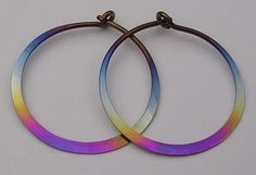 These pure niobium hoop earrings are one inch in diameter and have a very easy to work yet secure sideways action clasp. -From Etsy