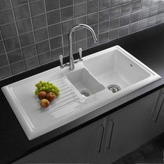White kitchen sink would look great against the wooden worktop of Fold House. Reginox - Traditional White Ceramic Kitchen Sink and Mixer Tap at Victorian Plumbing UK White Ceramic Kitchen Sink, Modern Kitchen Sinks, Kitchen Sink Design, Kitchen Mixer Taps, Ceramic Sink, Kitchen And Bath, New Kitchen, Cool Kitchens, Kitchen Decor