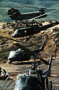 A twin-rotor helicopter and three single-rotor helicopters appear to be stacked atop one another during a supply airlift for support forces in Vietnam, March 22, 1971. --- Image by © Bettmann/CORBIS