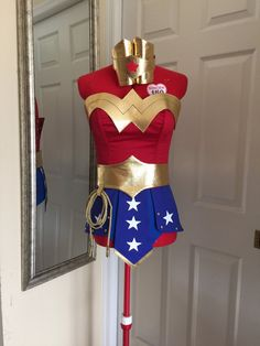 THIS WONDER WOMAN COSTUME WILL BE TAILORED TO YOUR MEASUREMENTS: PLEASE RESPOND THE FOLLOWING QUESTIONS: 1) I would need your following measurements: bust(the fullest part with the bra on) bra size below the bust waist(the narrowest part of the torso) hips(the widest part) wrist(measure just above the bone) how tall are you? When taking these measurements, use a cloth tape measure, not a metal one. Make sure that, when you circle your chest, waist, or hips, the tape is level and neither tooh…