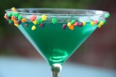 A Nerds martini : for 4 servings :   4 oz Smirnoff vodka, 2 oz Blue Curacao liqueur, 2 oz Sour Puss raspberry liqueur  sweet and sour mix & 4 splash grenadine syrup