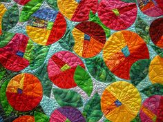 """In a Quilter's Garden II"" by Karen Krueger  Honorable Mention in Pieced, Small category. I like the log cabin blocks cut into circles, and also the quilting of different flower shapes within."