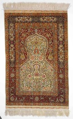A signed full silk Hereke rug, Turkey. App. 2.7 mio. kn. pr sqm. second half 20th century. 118 x 70 cm. Est. 2700-3200.- Euro.