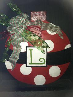 Wooden Ornament Door Hanger. $40.00, via Etsy.