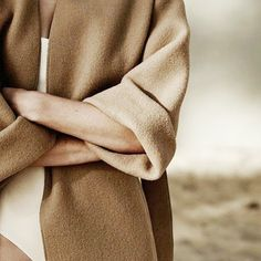Rolled up sleeves, nude colored coat.
