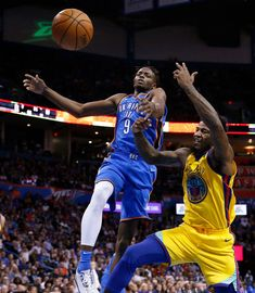 Golden State Warriors center Jordan Bell (2) knocks the ball away from Oklahoma City Thunder forward Jerami Grant (9) during the second half of an NBA basketball game in Oklahoma City, Tuesday, April 3, 2018. (AP Photo/Sue Ogrocki)