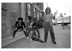 Syl & David of the New York Dolls playing with kids on 2nd Ave., NYC, 1975. Photo by Leee Childers.