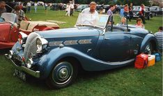 16 2-litre 6-cylinder engine. In July 1938 a slightly longer wheelbase version powered by a 1,991 cc engine fed by triple SUs joined the range while the saloon version featuring the same 1991 cc engine still made do with just two SU carburettors. No power output figure was quoted by the manufacturers for the 1991 cc Dolomite.
