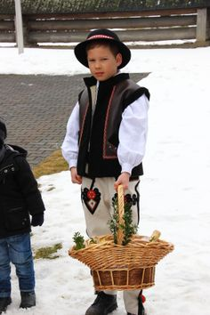 The Blessing of Easter Baskets in Poland in mountains. On the photo young góral (polish highlander).