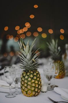 Pineapples as centerpieces - love this idea | Photo by Chellise Michael Photography via http://junebugweddings.com/wedding-blog/bohemian-block-island-wedding/