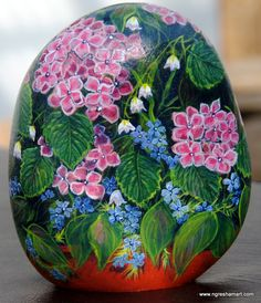 pretty hand painted rock, rock art, patio flowers that don't need watered