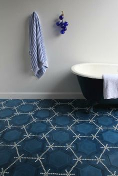 A modern take on Moroccan tile design - The Hex Dot from Marrakech-based Popham Design is available in any combination of hand-mixed colors. Floor Design, Tile Design, House Design, Bathtub Tile, Bathroom Floor Tiles, Design Bathroom, Blue Tiles, White Tiles, Floor Patterns