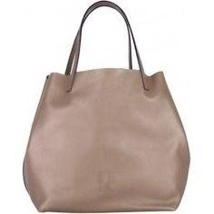 Eva Mendes wearing Ch Carolina Herrera Matryoshka Bag.